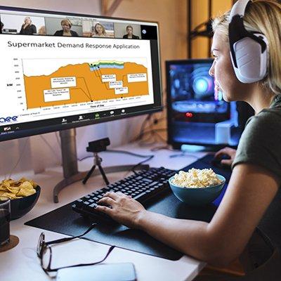 Focused young blonde working on her desktop computer