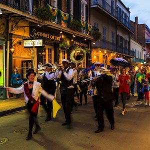 New Orleans USAFeb2 2016:Visitors and localsareall over in the French Quarter'sstreets of New Orleans. People arecelebrating and partying while enjoying the streetmusic.Thisisan ongoinglifestyle . There are a lot of talented artists in the city.